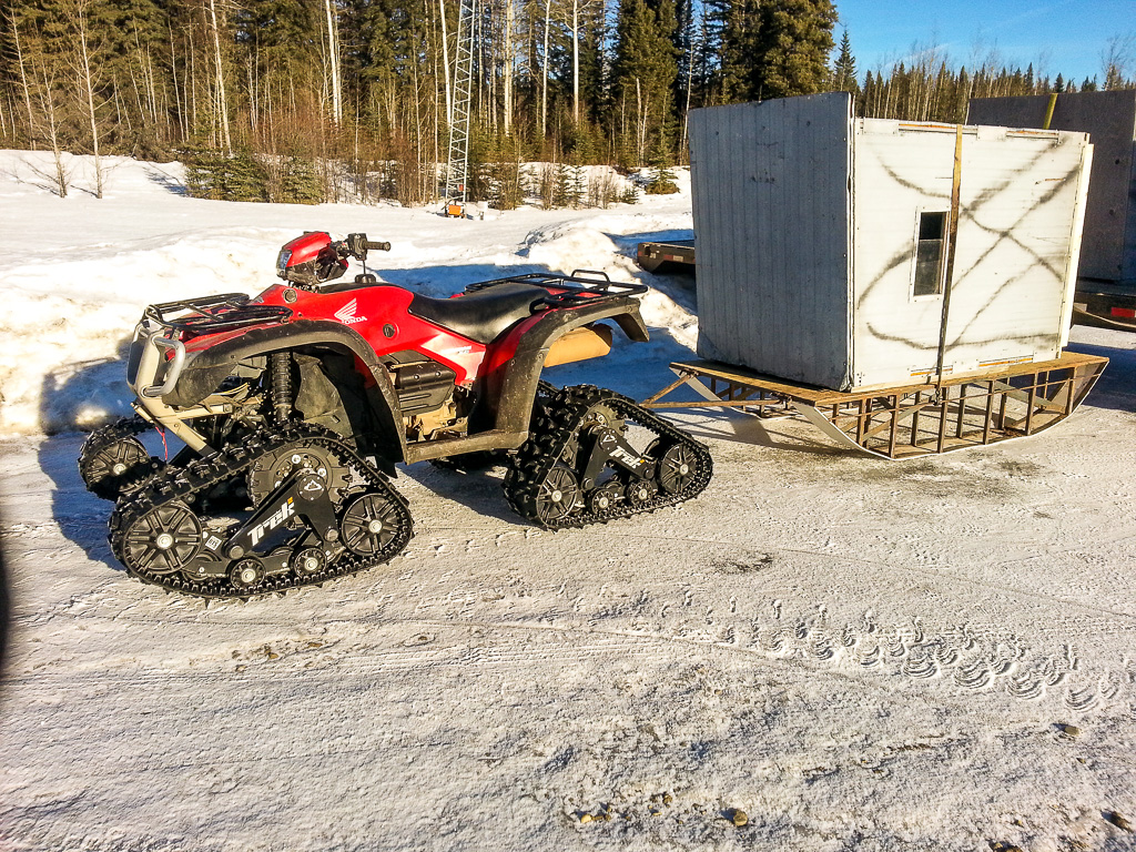 Treaded quad (ATV) used by Alpine Outfitters for hunting in Alberta, Canada